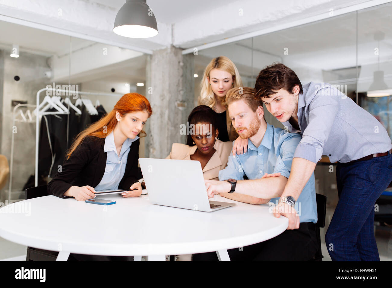 Creative business people and designers  brainstorming in a modern office - Stock Image