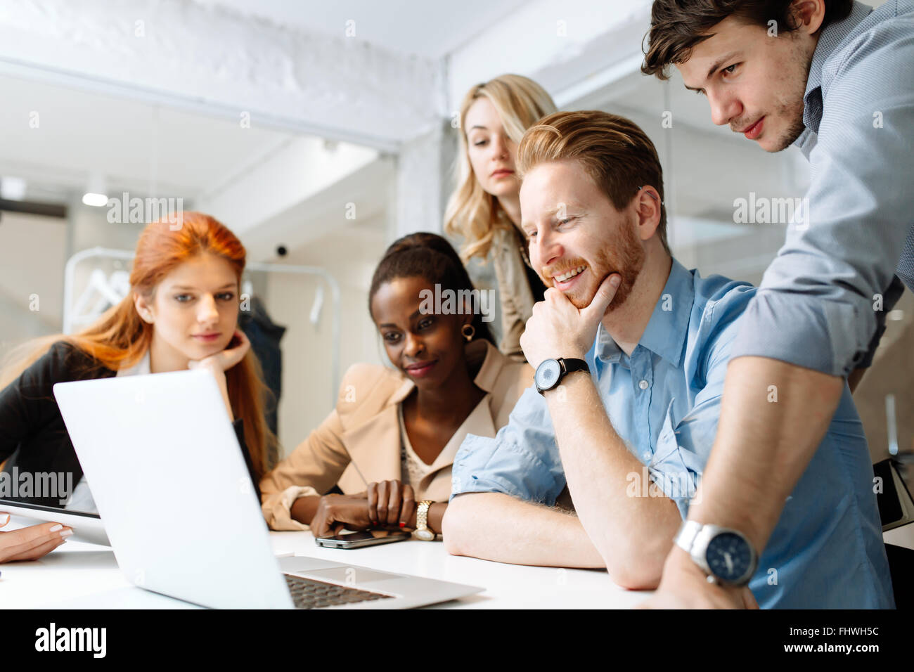 Group of business people working in office and discussing new ideas - Stock Image