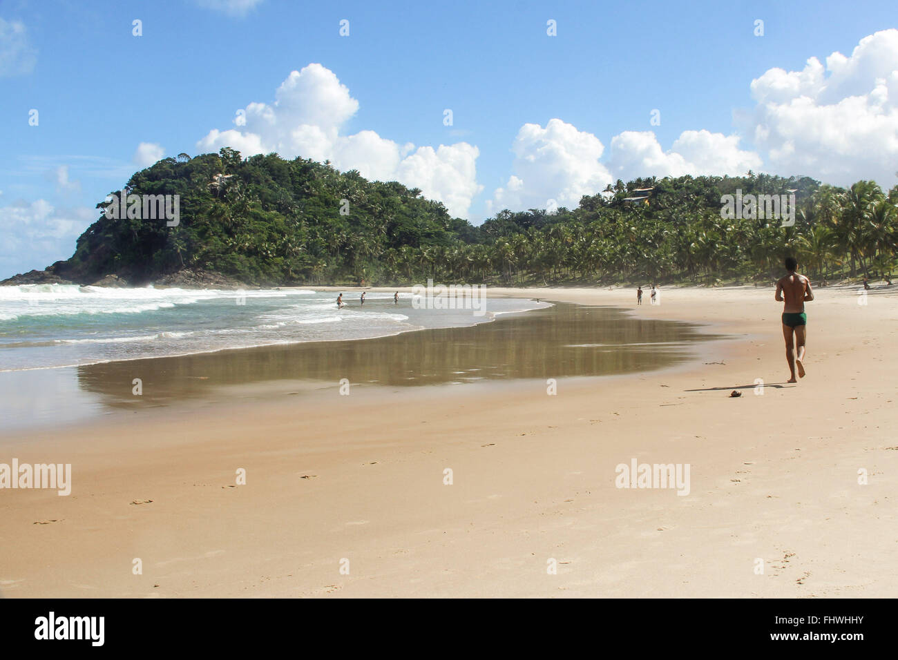 Bather exercising on the edge of Prainha - Stock Image