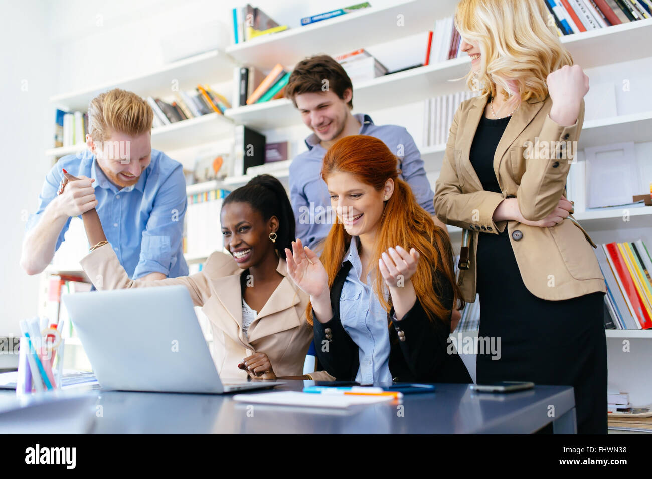 Happy business coworkers happy about company success and recent achievement - Stock Image