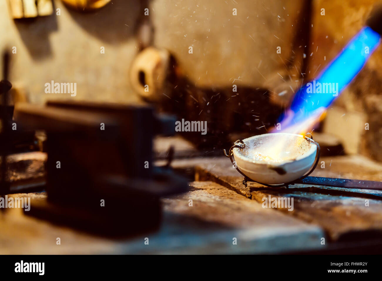 Jeweler welding gold the traditional way Stock Photo