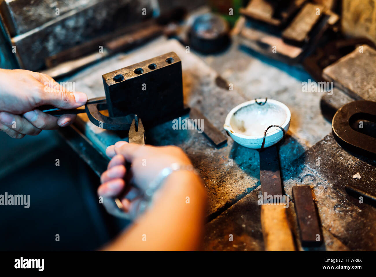 Goldsmith crafting jewels the traditional way Stock Photo