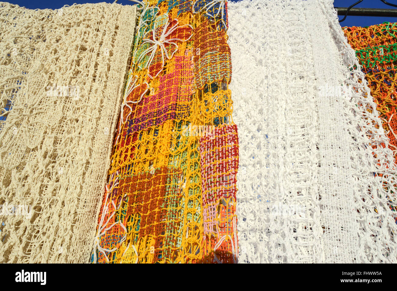 Detail of lace tablecloths sold on craft fair on the edge of Iracema Beach - Stock Image