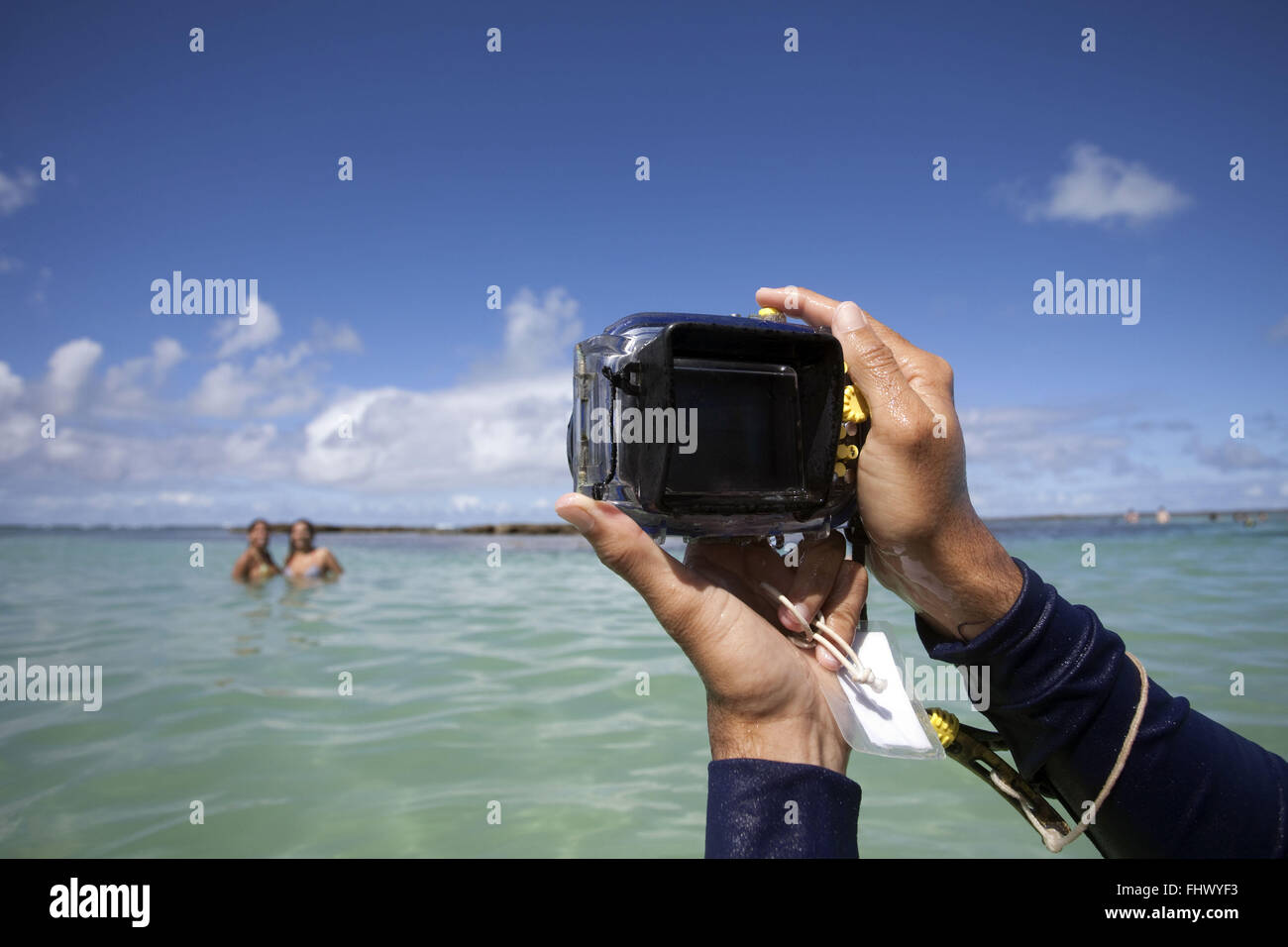 Tourists being photographed during walk on coral reef in Maragogi Beach - Stock Image