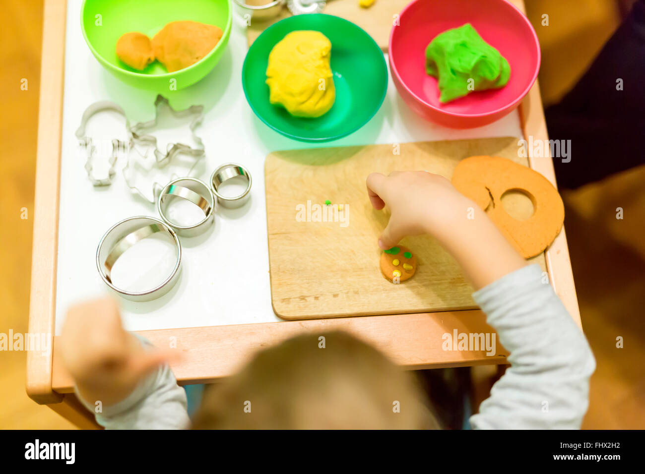 Creative kid playing with playdough - Stock Image
