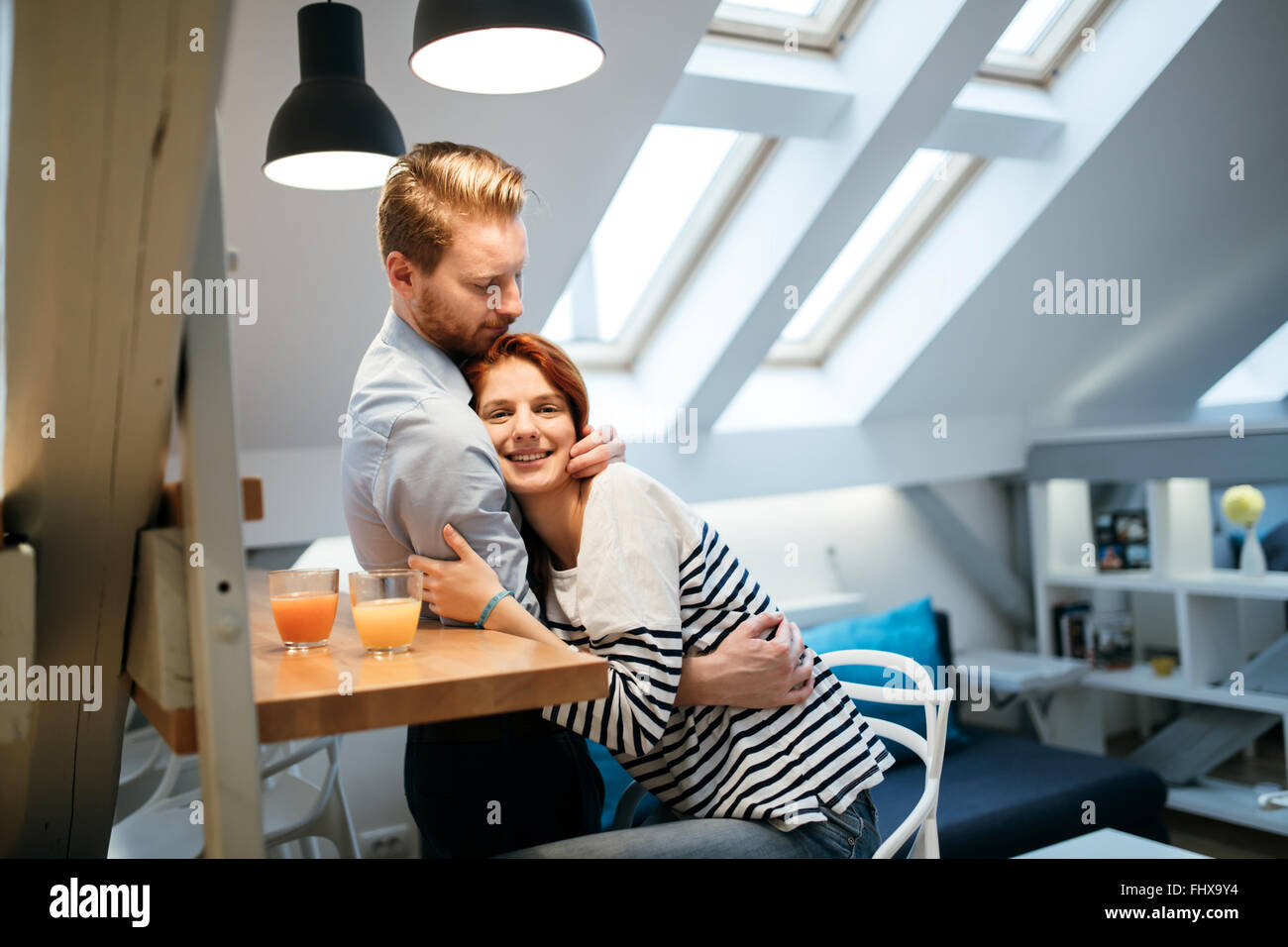 Couple in love hugging to show their feelings whever possible - Stock Image