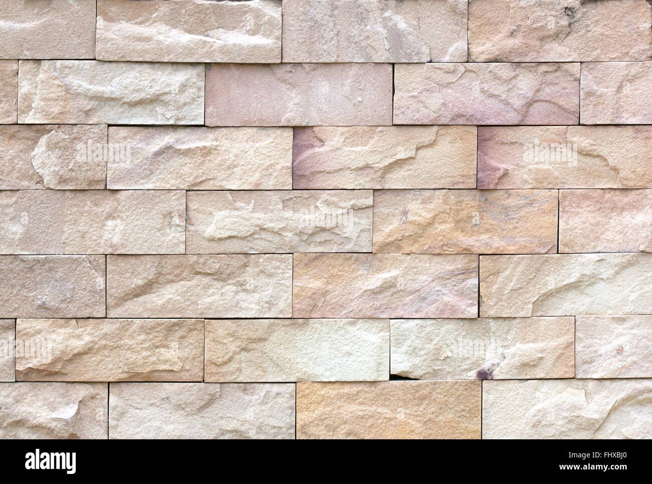 Texture of stone walls, exterior durability. Construction materials industry - Stock Image