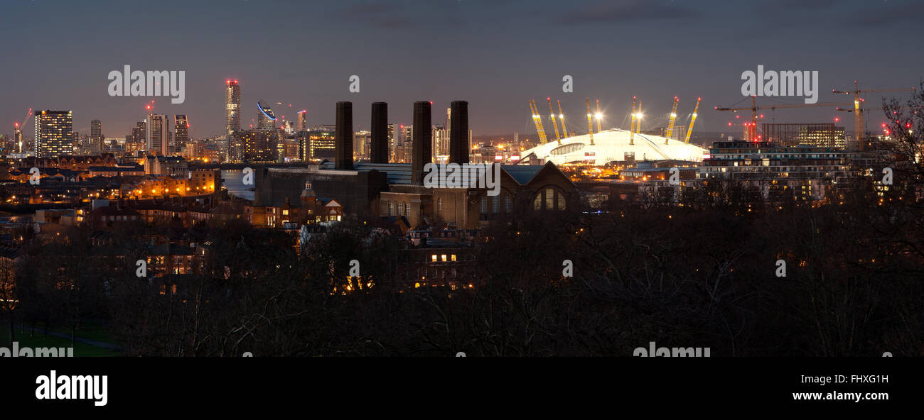 London, UK - JANUARY 7, 2016: Panorama of Canary Wharf in night. View includes the park, National Maritime Museum, - Stock Image