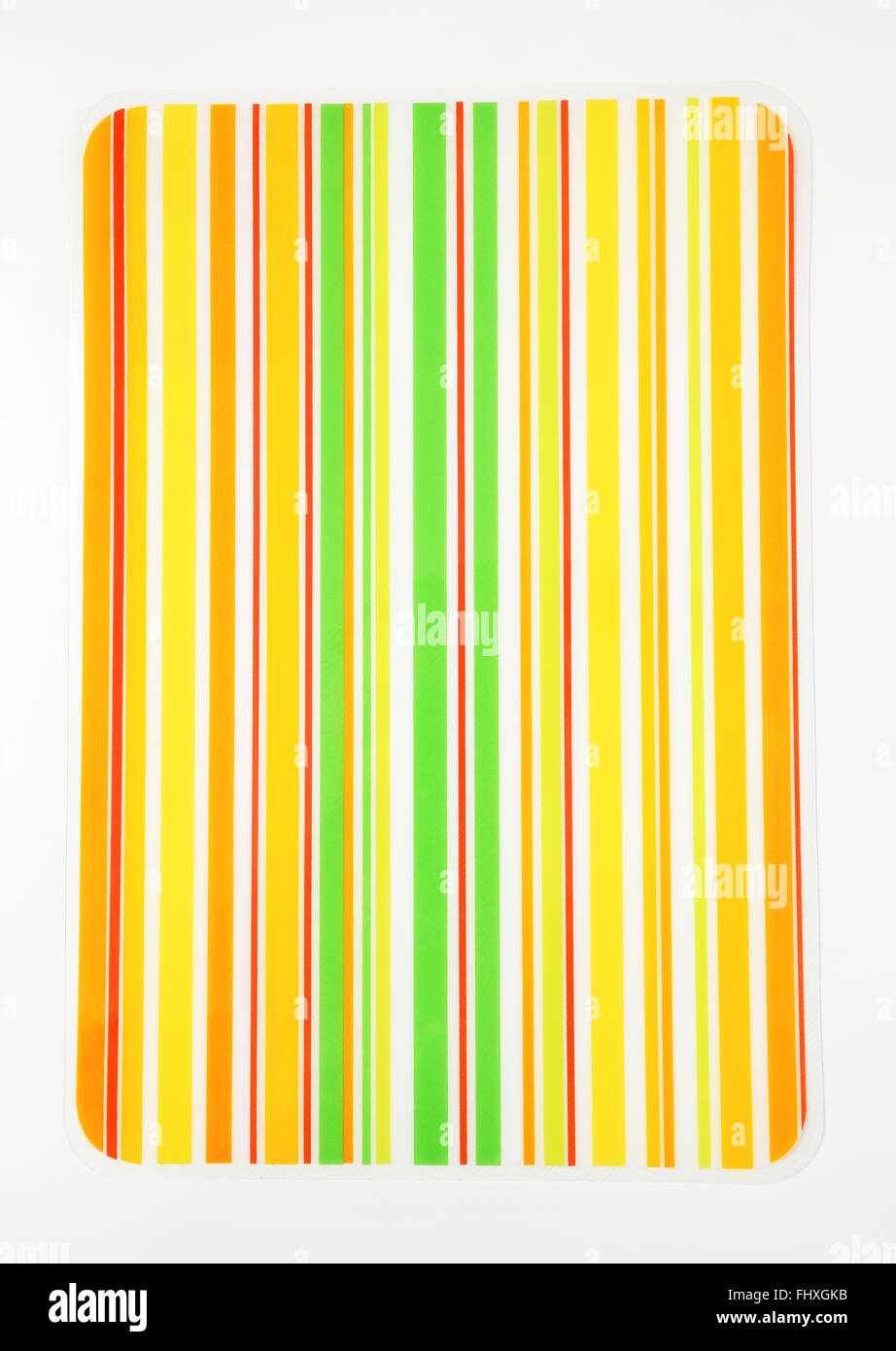 Laminated brightly colored striped table mat - Stock Image