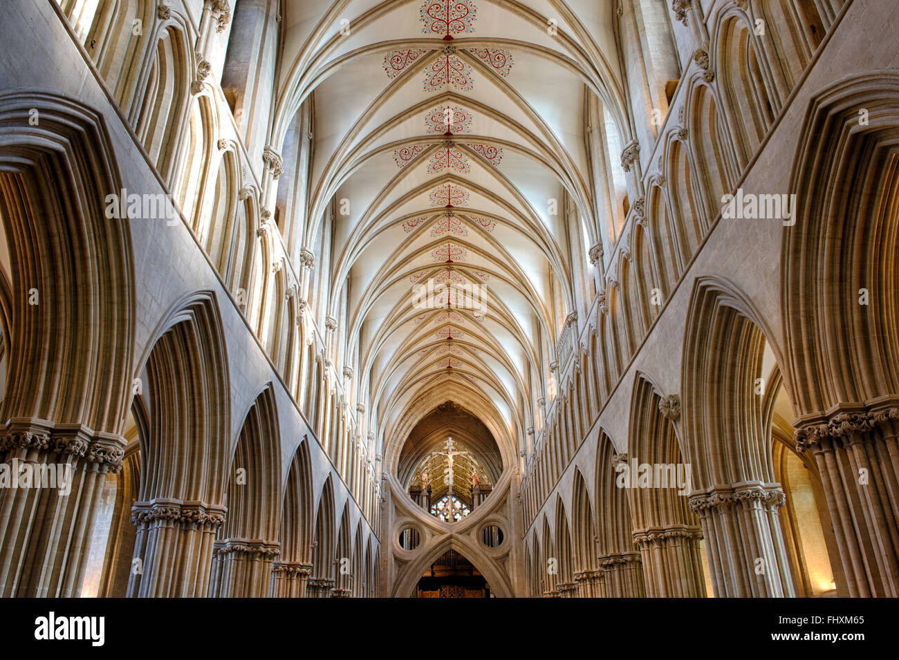 Wells Cathedral Nave. Vaulted ceiling / St Andrews Cross arches / Scissor arch and Jesus Christ crucified on the - Stock Image