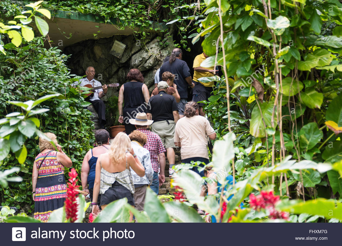 Cuba tourism: line of tourists entering the Cave of the Indian. The landmark features and excursion in boat in a - Stock Image