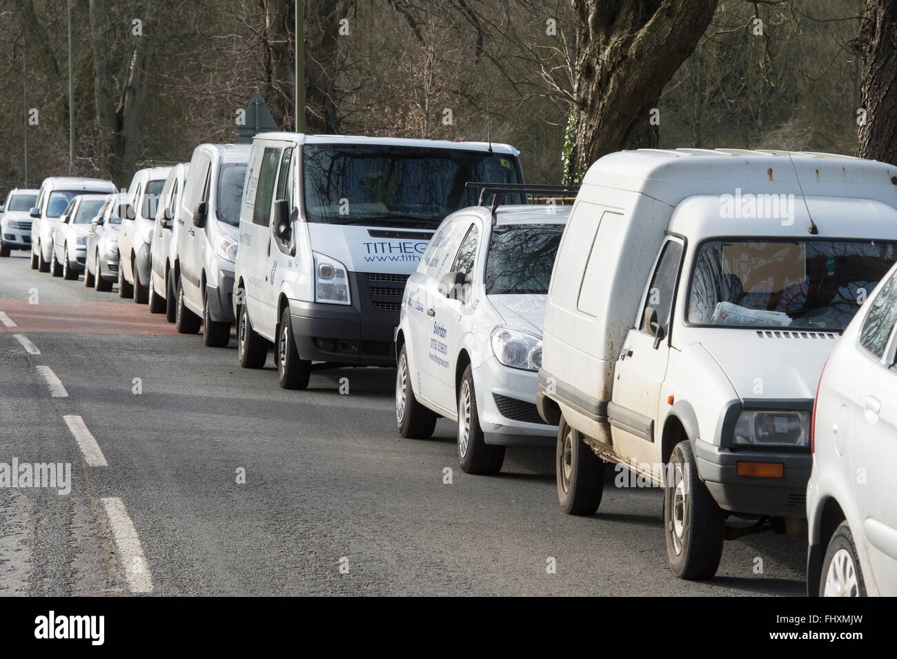 cd5ed85621 White contractors vans parked outside a building site on the road in  Chipping Norton. Oxfordshire