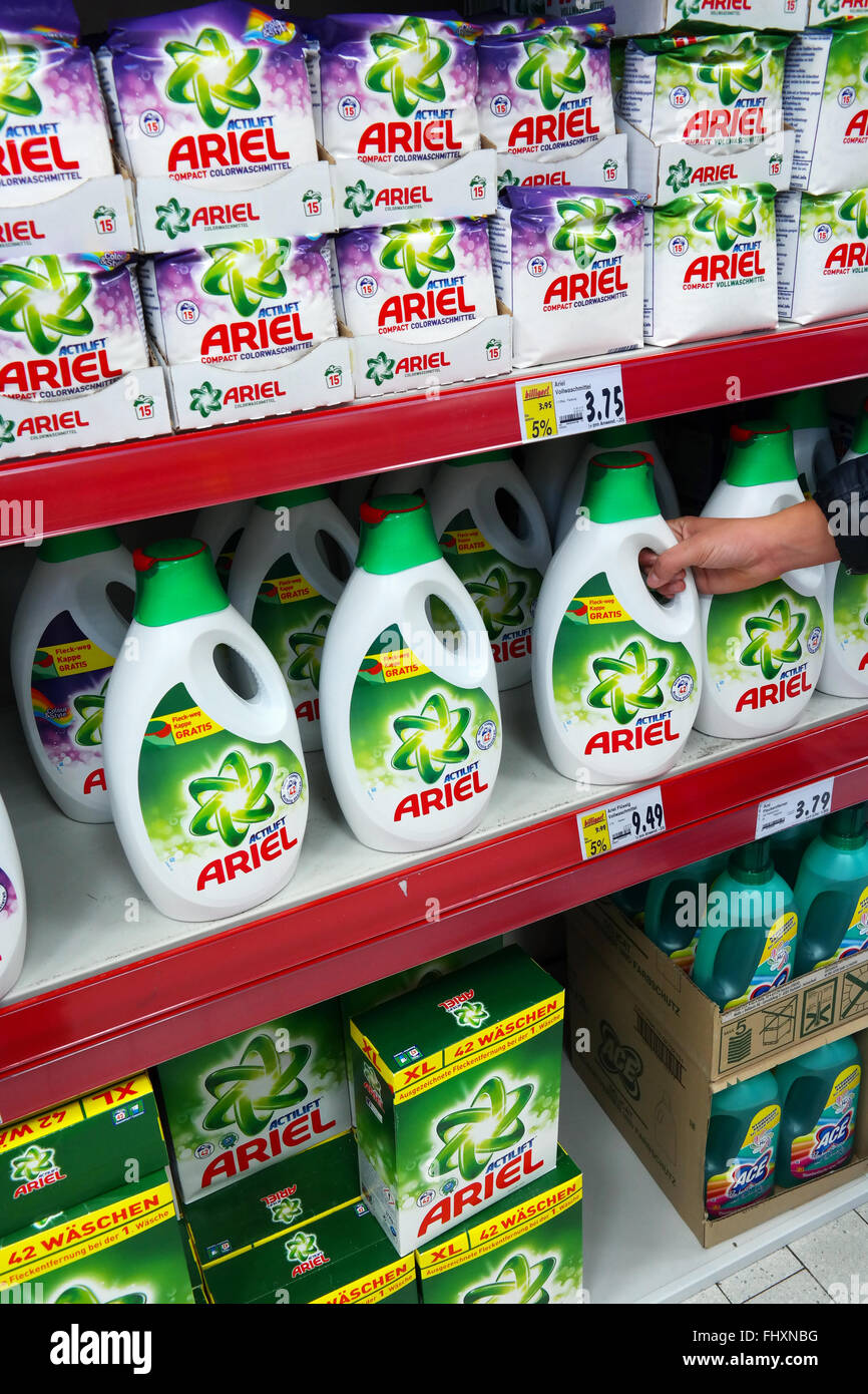 Shelves filled with Ariel, a line of laundry detergents, in a Kaufland hypermarket. - Stock Image
