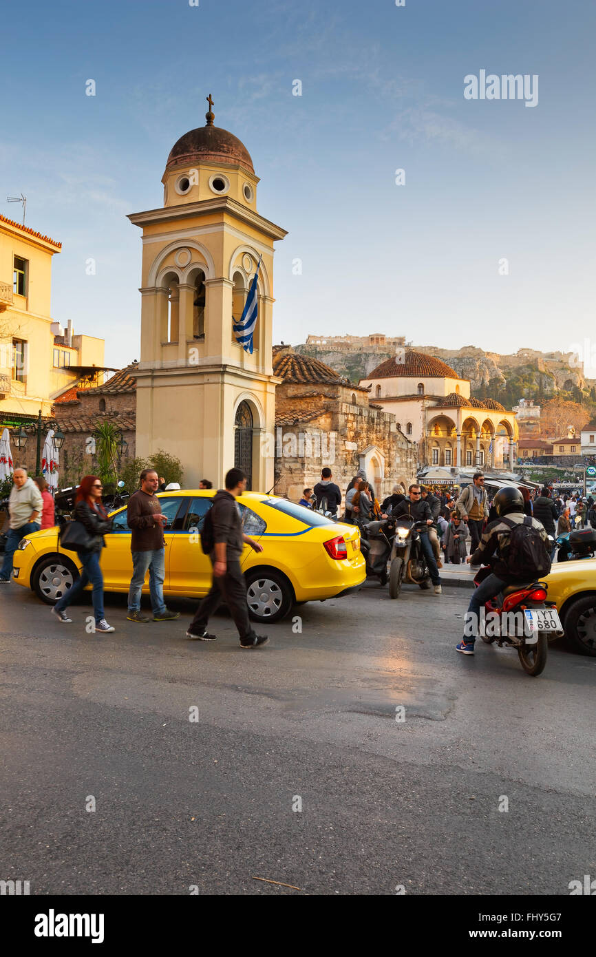 People and taxis at a church in Monastiraki square in Athens. - Stock Image