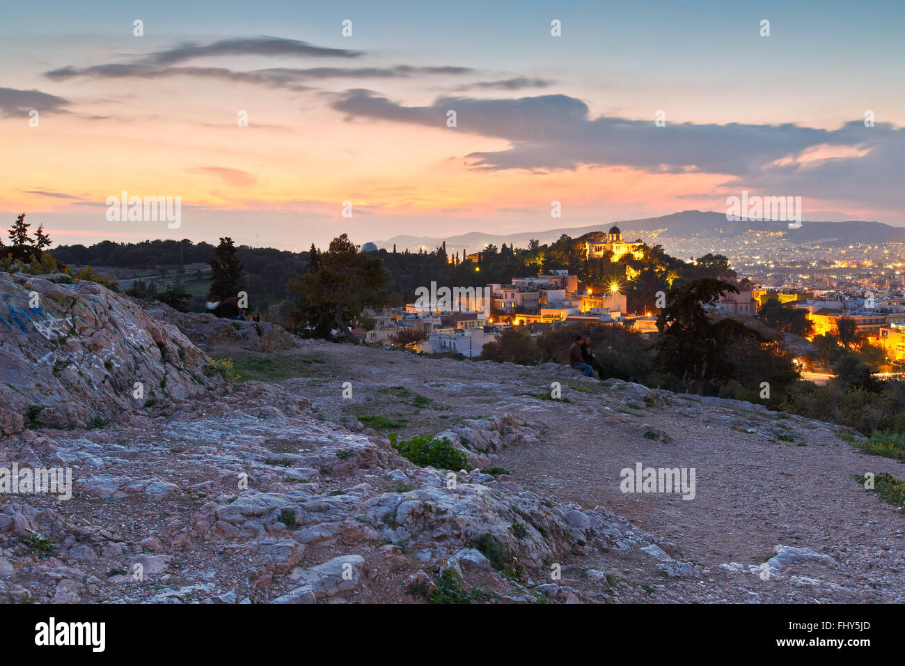 View of Thissio dominated by the National Observatory from Areopagus hill. - Stock Image