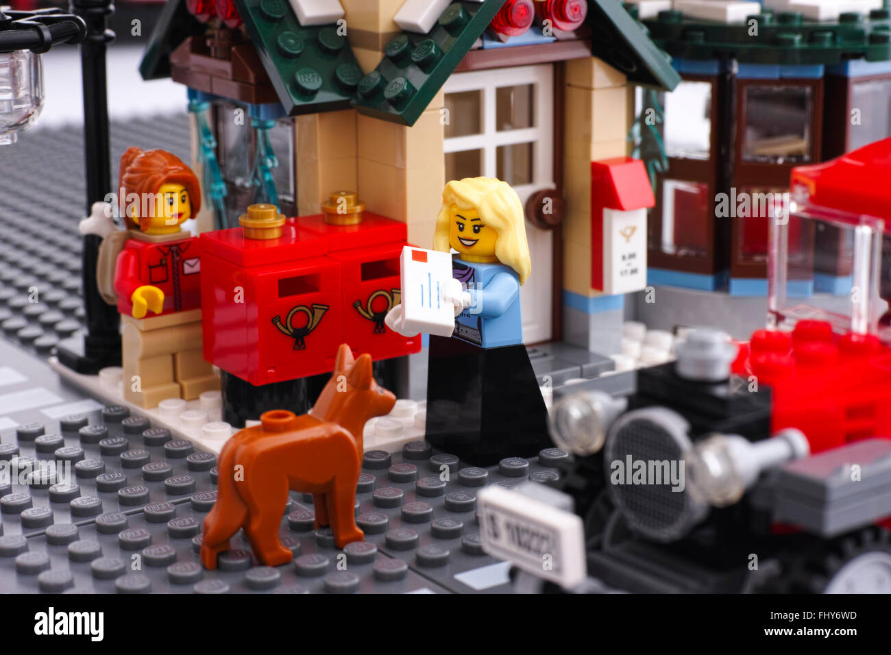 Lego Post Office In Street There Are Two Women And Dog Minifigures Near The