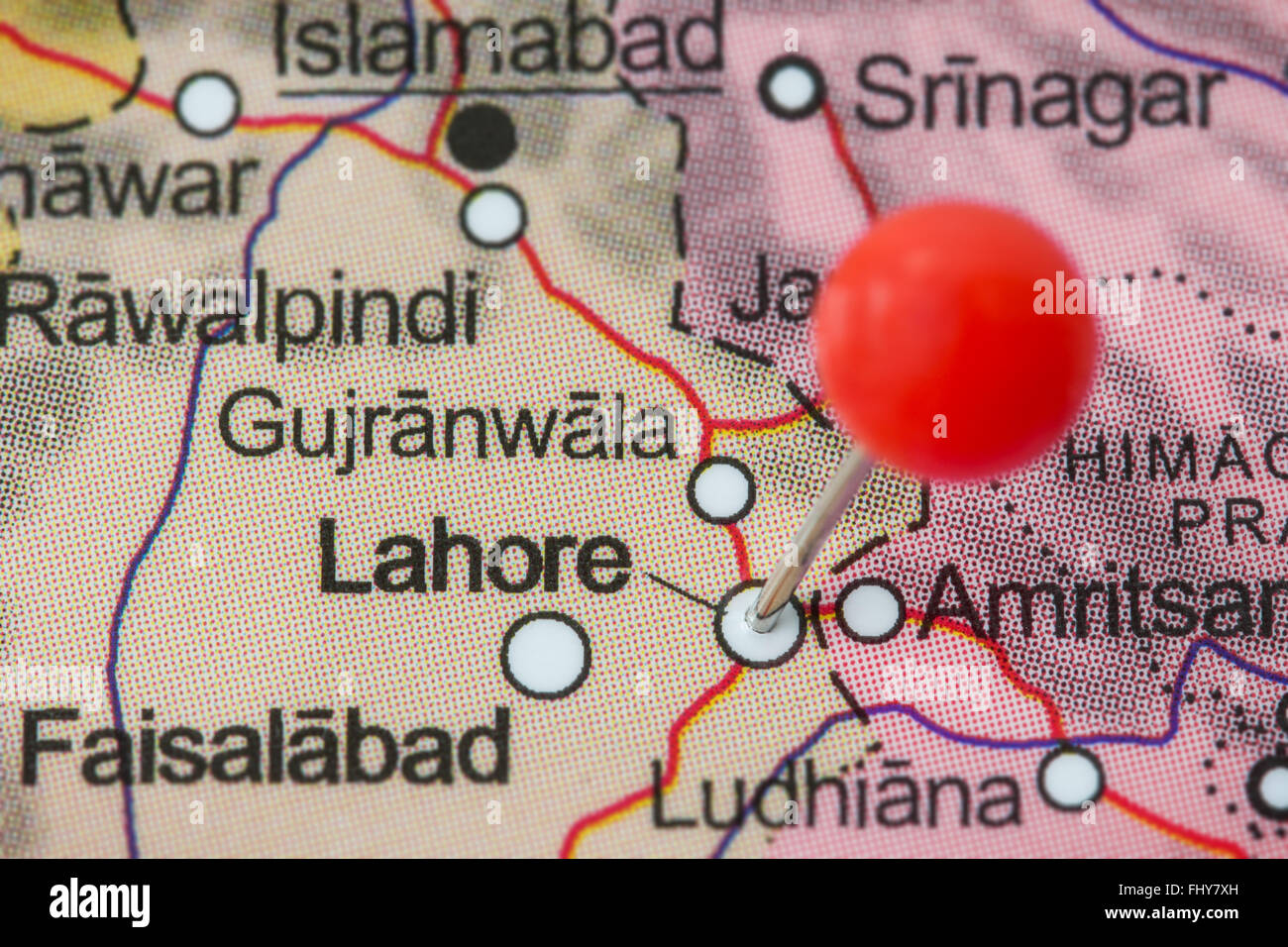 Close-up of a red pushpin in a map of Lahore, Pakistan Stock