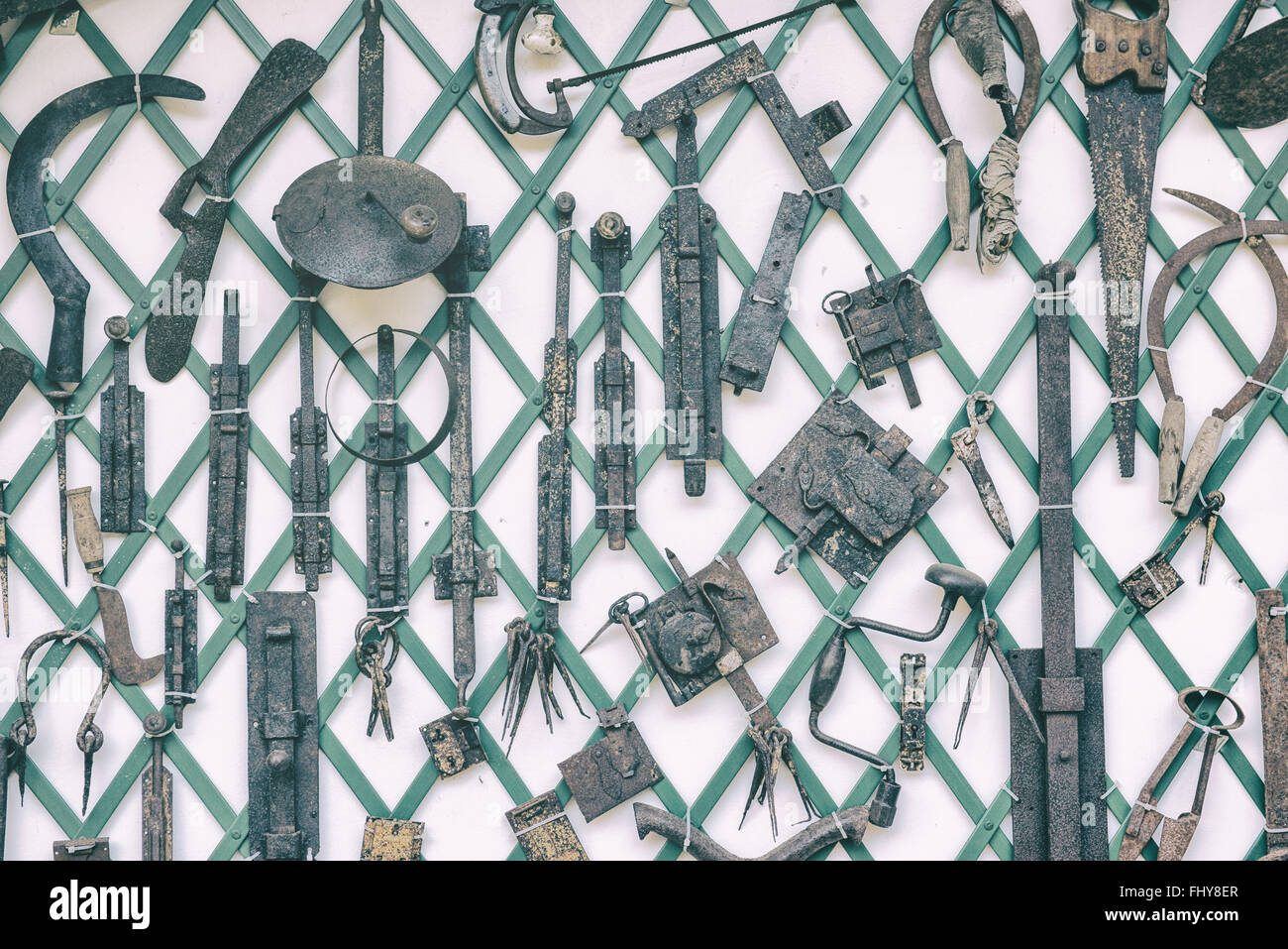 old garden tools, locks, chains, fasteners, saws - Stock Image