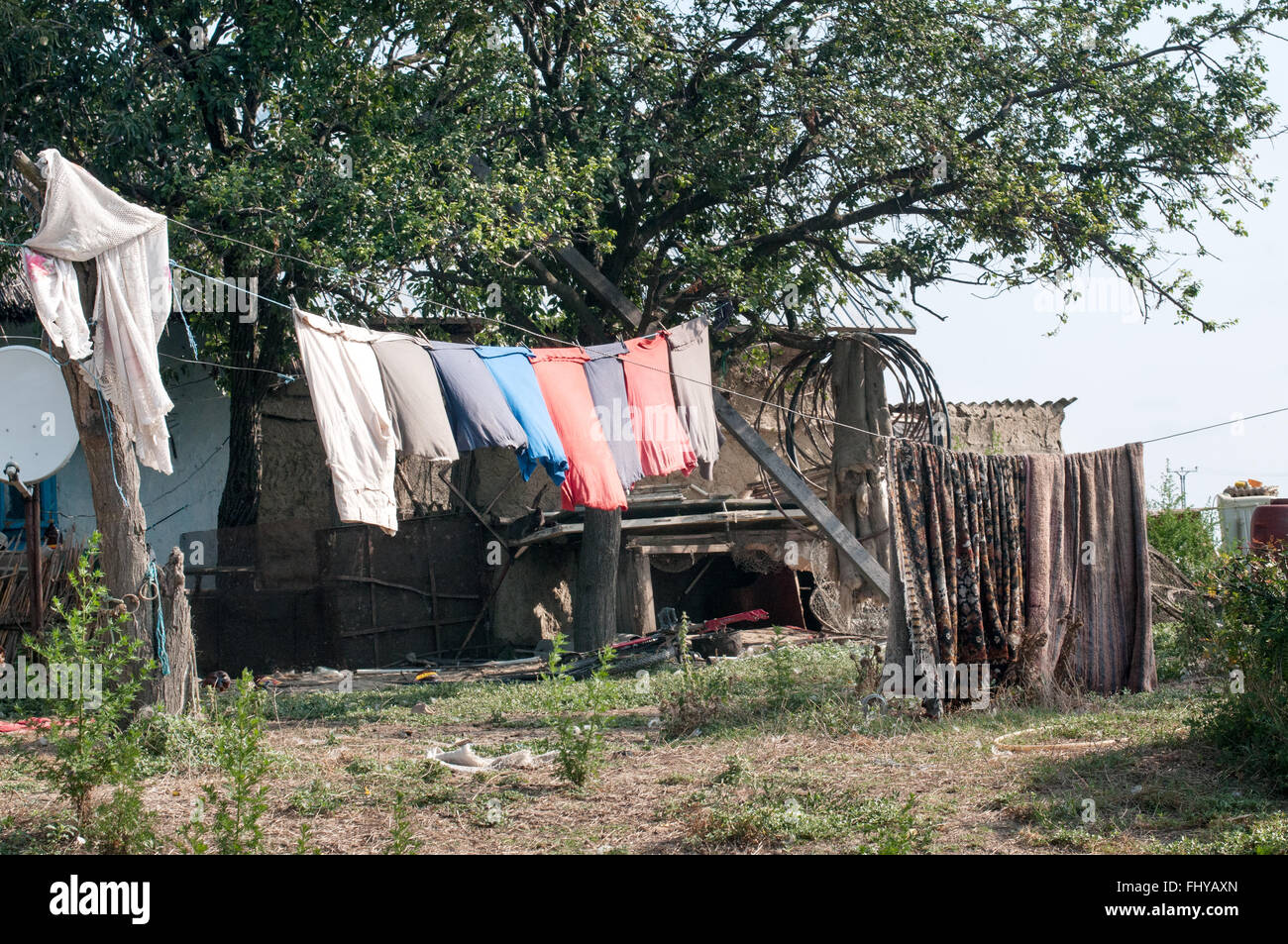 old wooden country houses with various dress at the sun - Stock Image