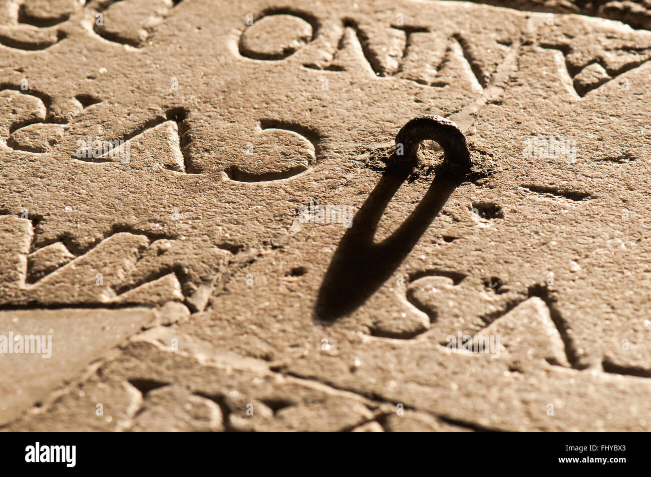 written on the church rock with eyelet in shadow - Stock Image