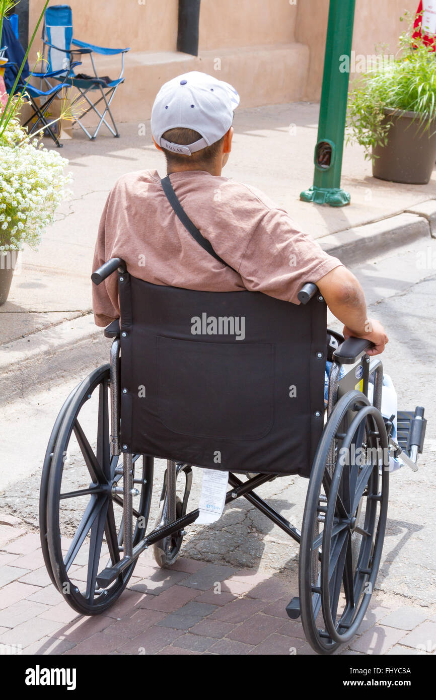 Tourist in wheel chair wheelchair at Santa Fe Indian Market - Stock Image
