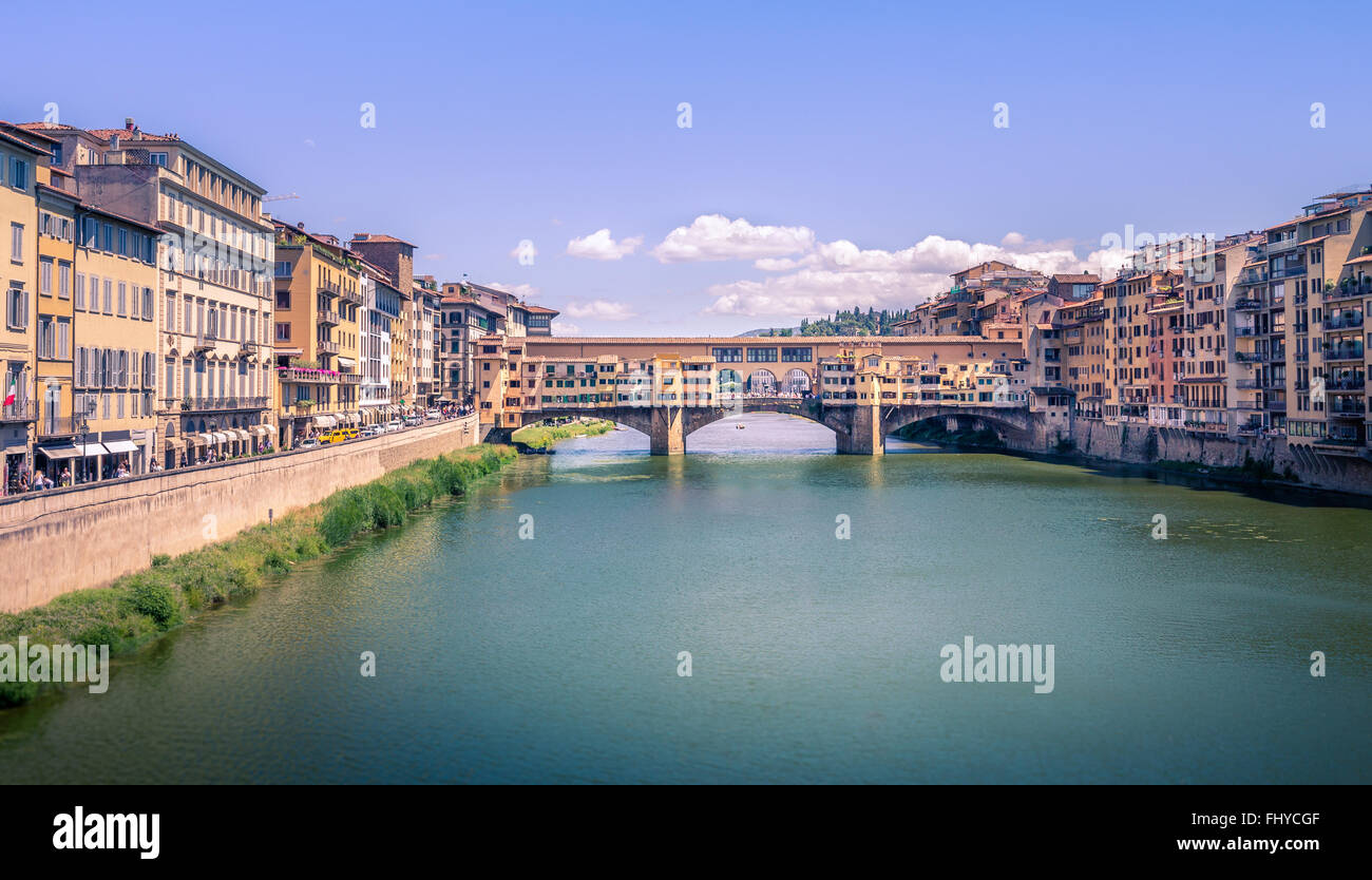 Famous bridge Ponte Vecchio and Arno river in Florence, Italy - Stock Image