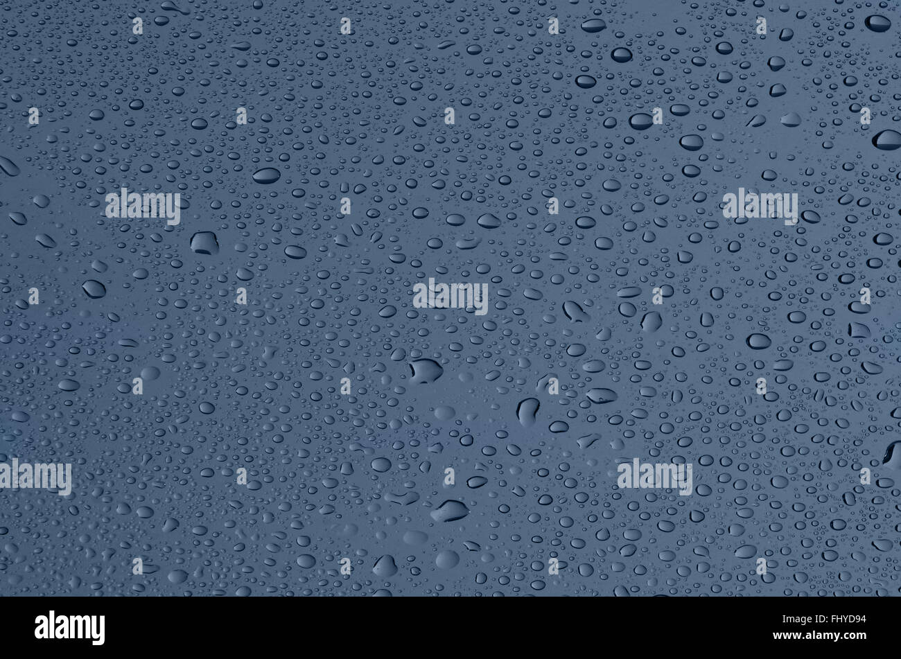 Drops on glass, a grey-blue background Stock Photo