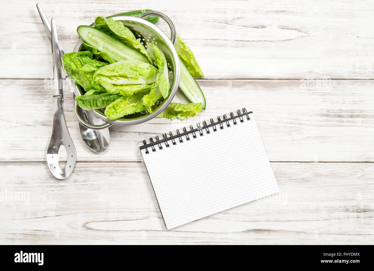 Green salad leaves and recipe book on white wood kitchen table stock green salad leaves and recipe book on white wood kitchen table healthy food concept forumfinder Gallery