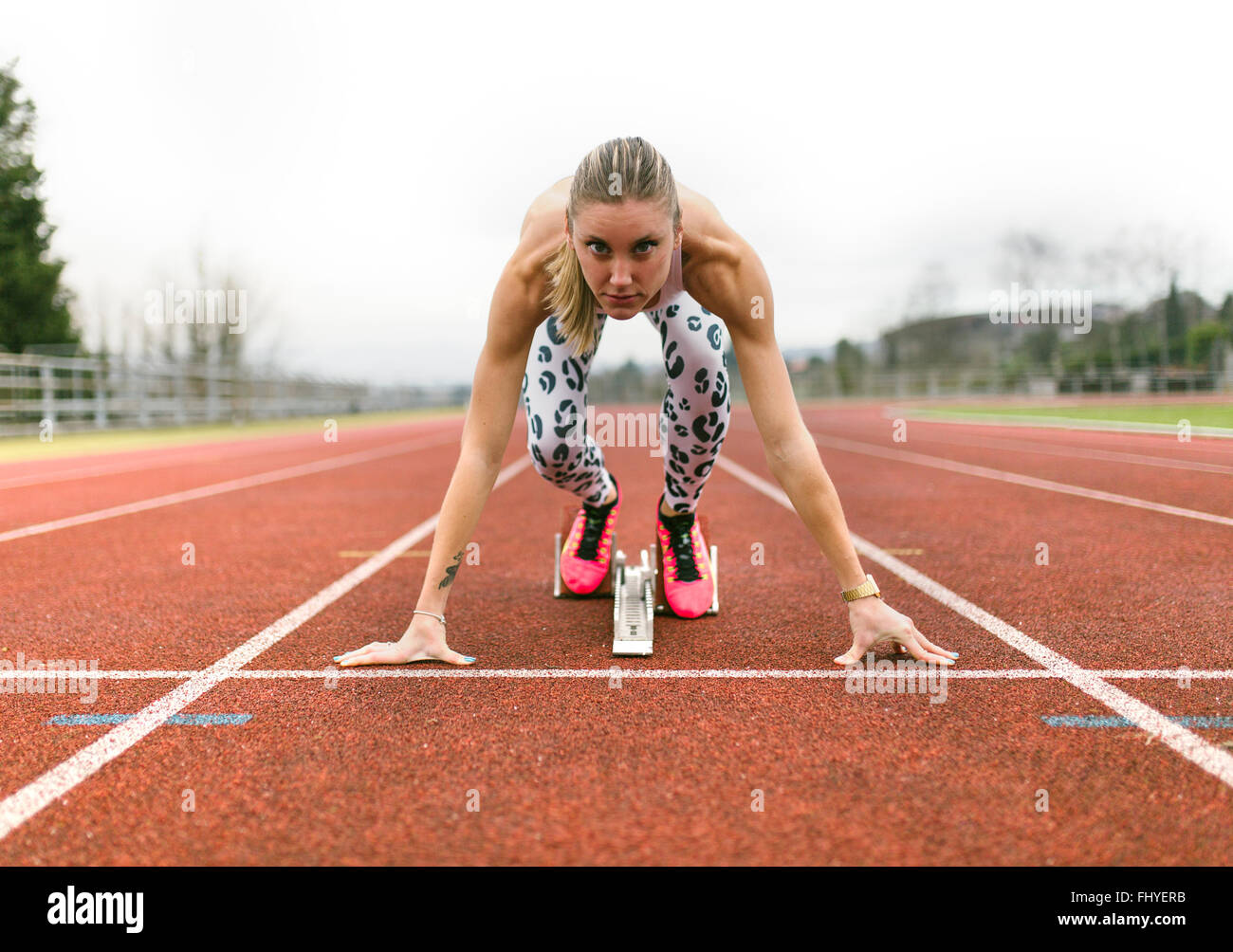 Athlete woman on a running track Stock Photo