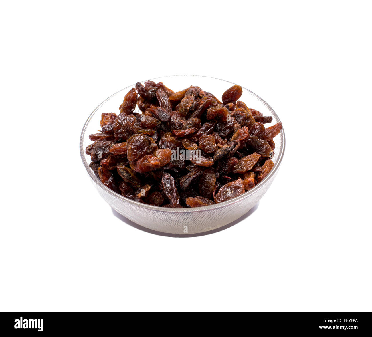 the transparent bowl filled with raisin Stock Photo