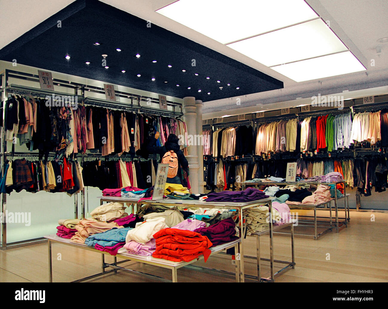 741b0f7aae7 Lady shopping women's clothes department Dublin Ireland Stock Photo ...