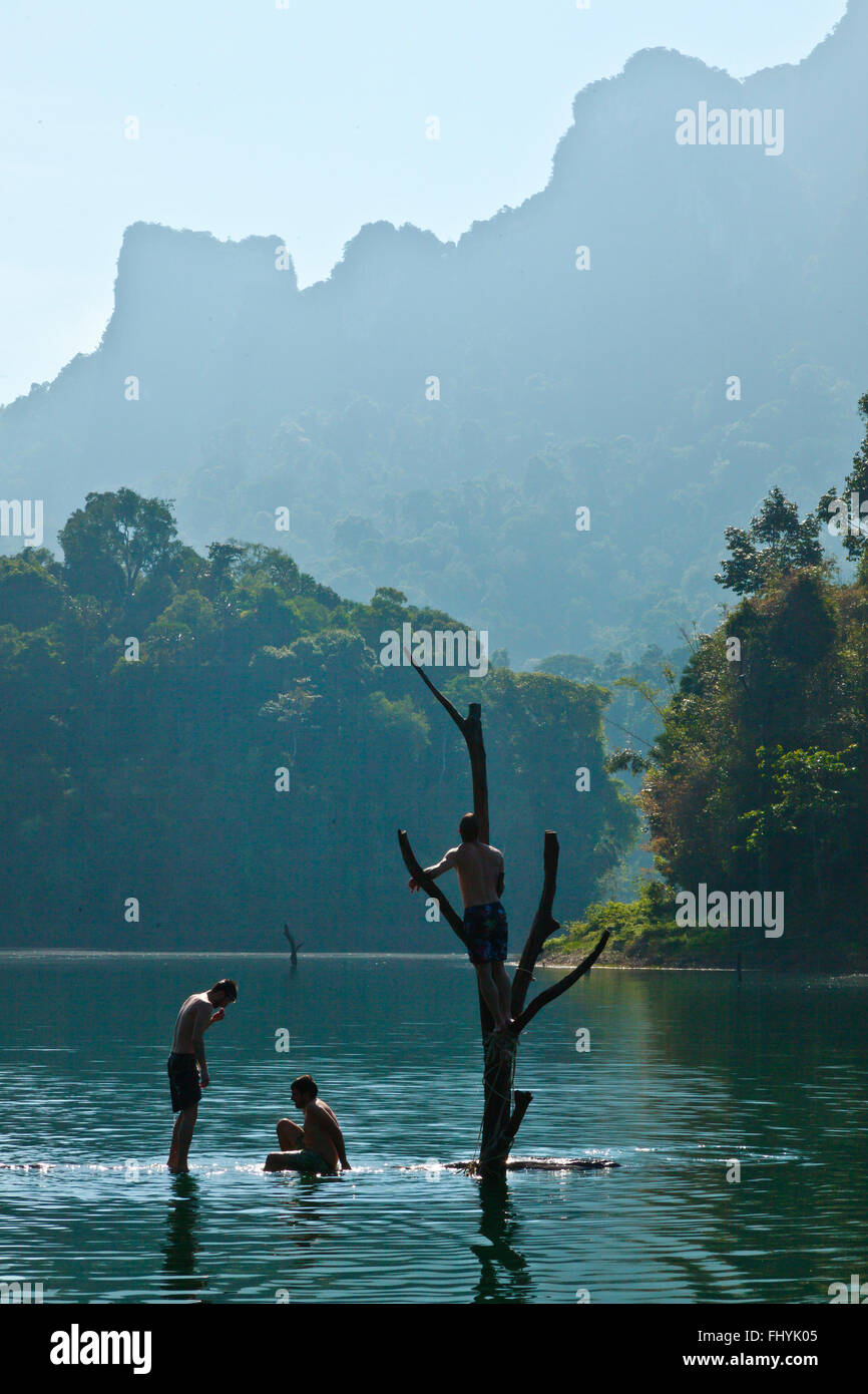Swimming in TAM GIA RAFT HOUSE on CHEOW EN LAKE in KHAO SOK NATIONAL PARK - THAILAND - Stock Image