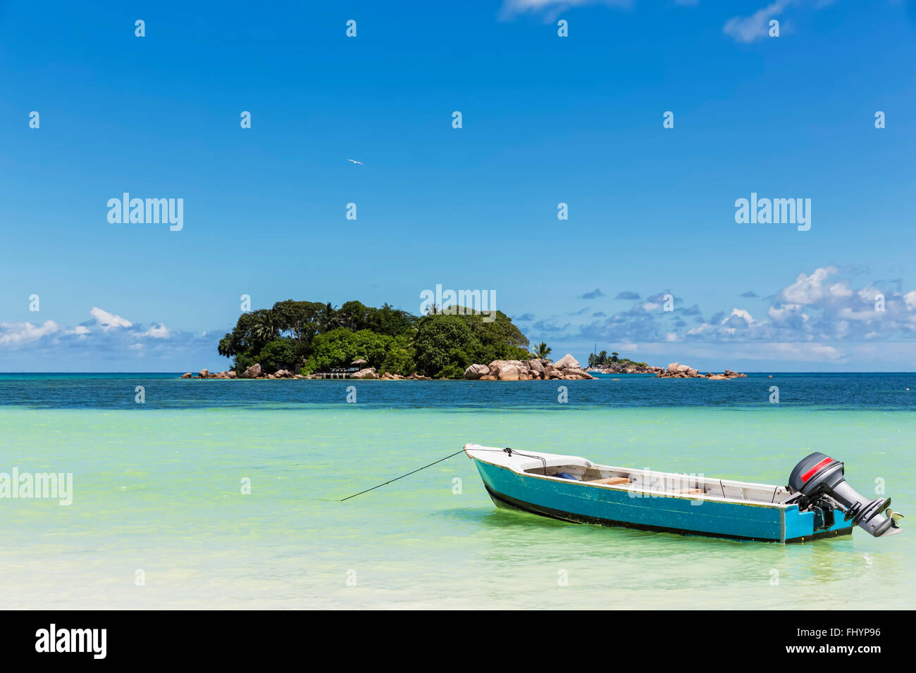 Seychelles, Praslin, Anse Volbert, motorboat, Chauve Souris Island and Saint Pierre Stock Photo