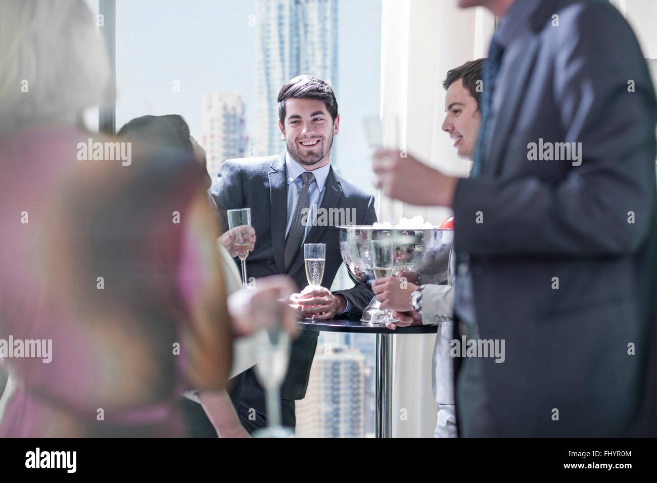 Successful business people having a work party - Stock Image