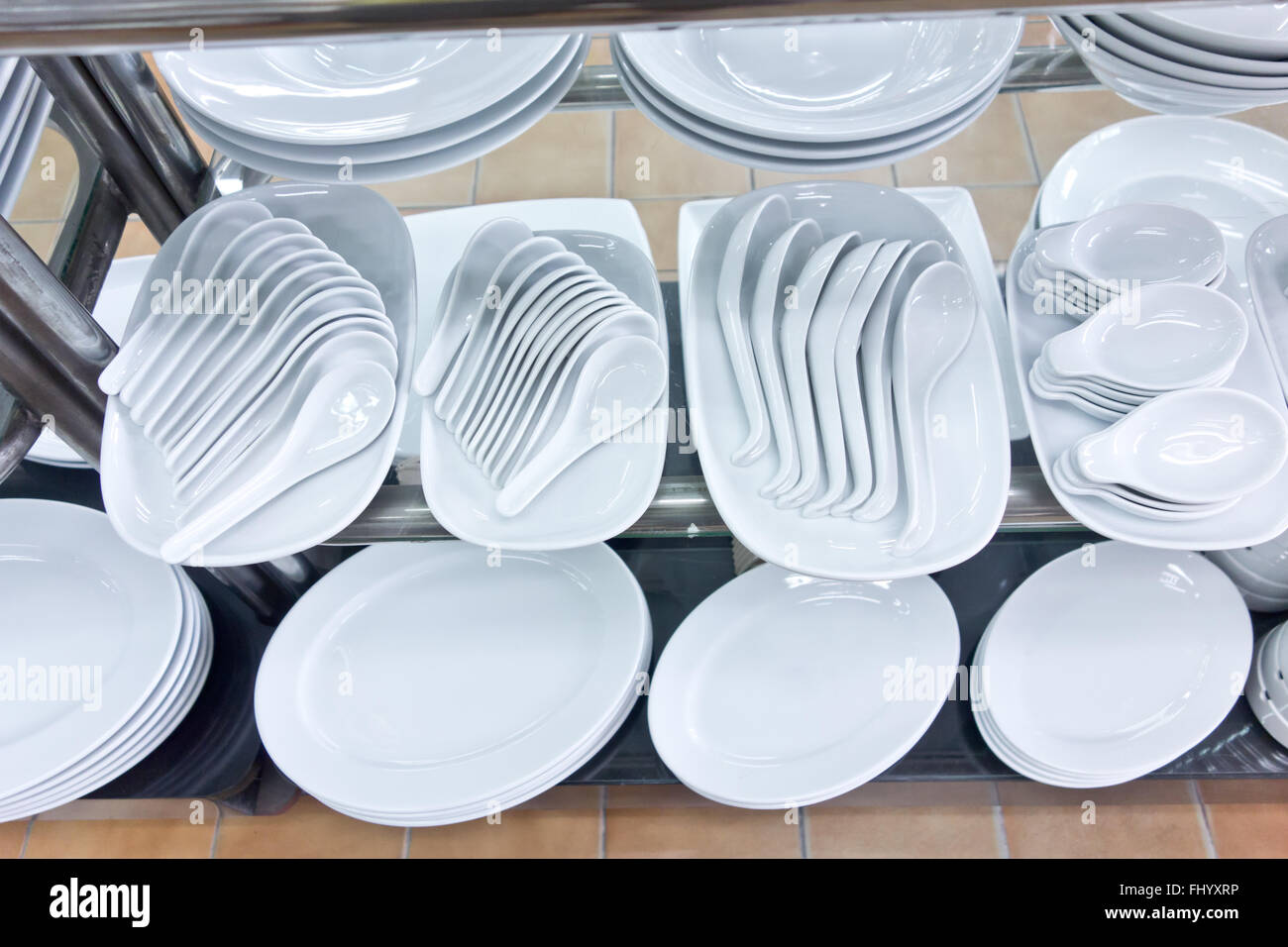 white plates and chinese spoons - Stock Image