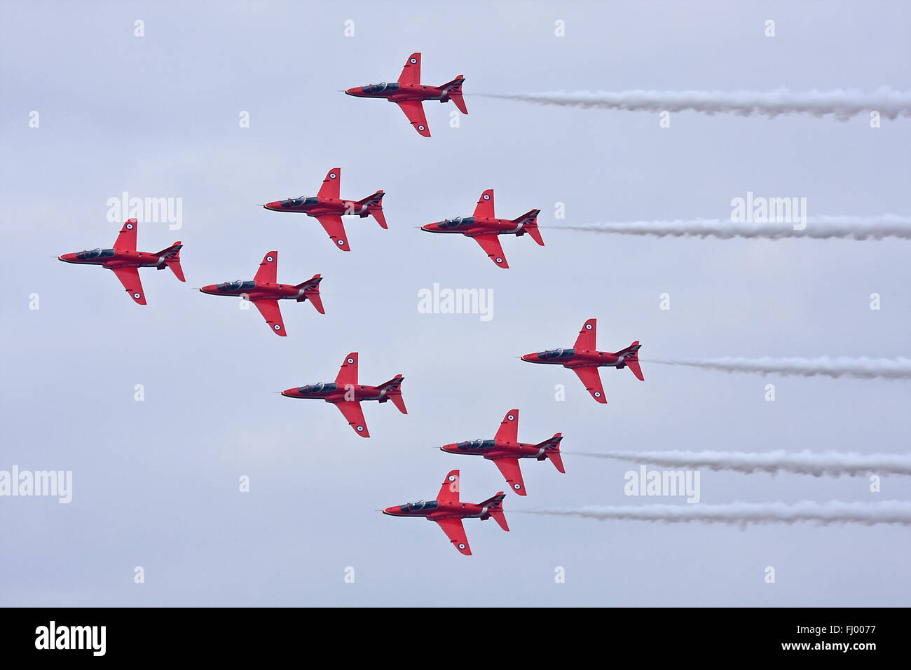 RAF Aerobatic Team The Red Arrows performing over RAF Coningsby. - Stock Image