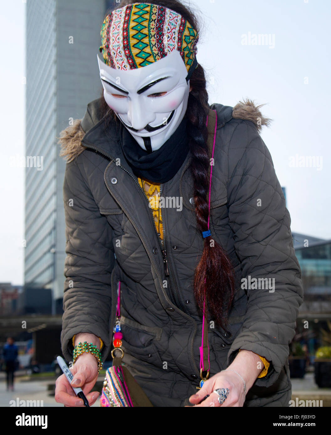 Man wearing anonymous face mask ;  Manchester, UK 27th February 2016. Anon Street Team, ( Wake Up Manchester), arrive - Stock Image