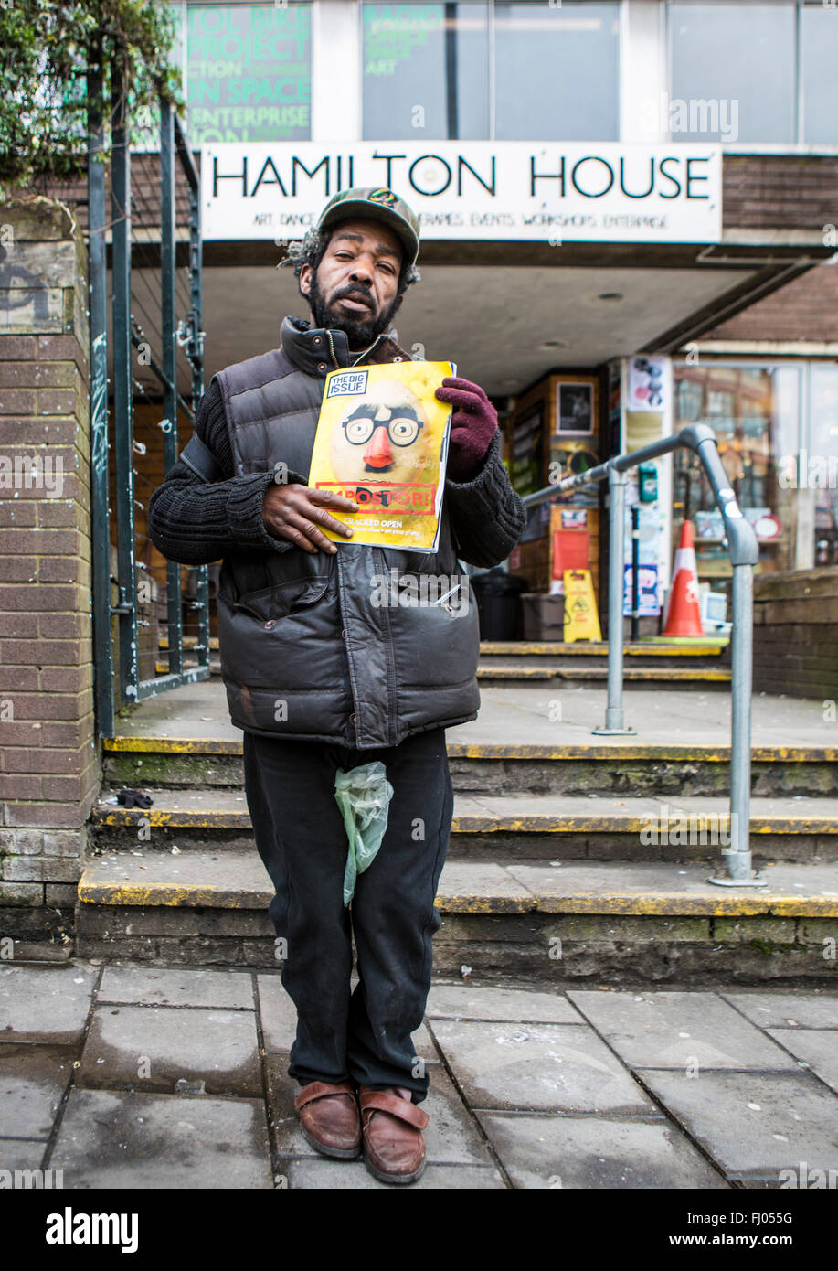 Big Issue Seller in Stokes Croft Bristol - Stock Image