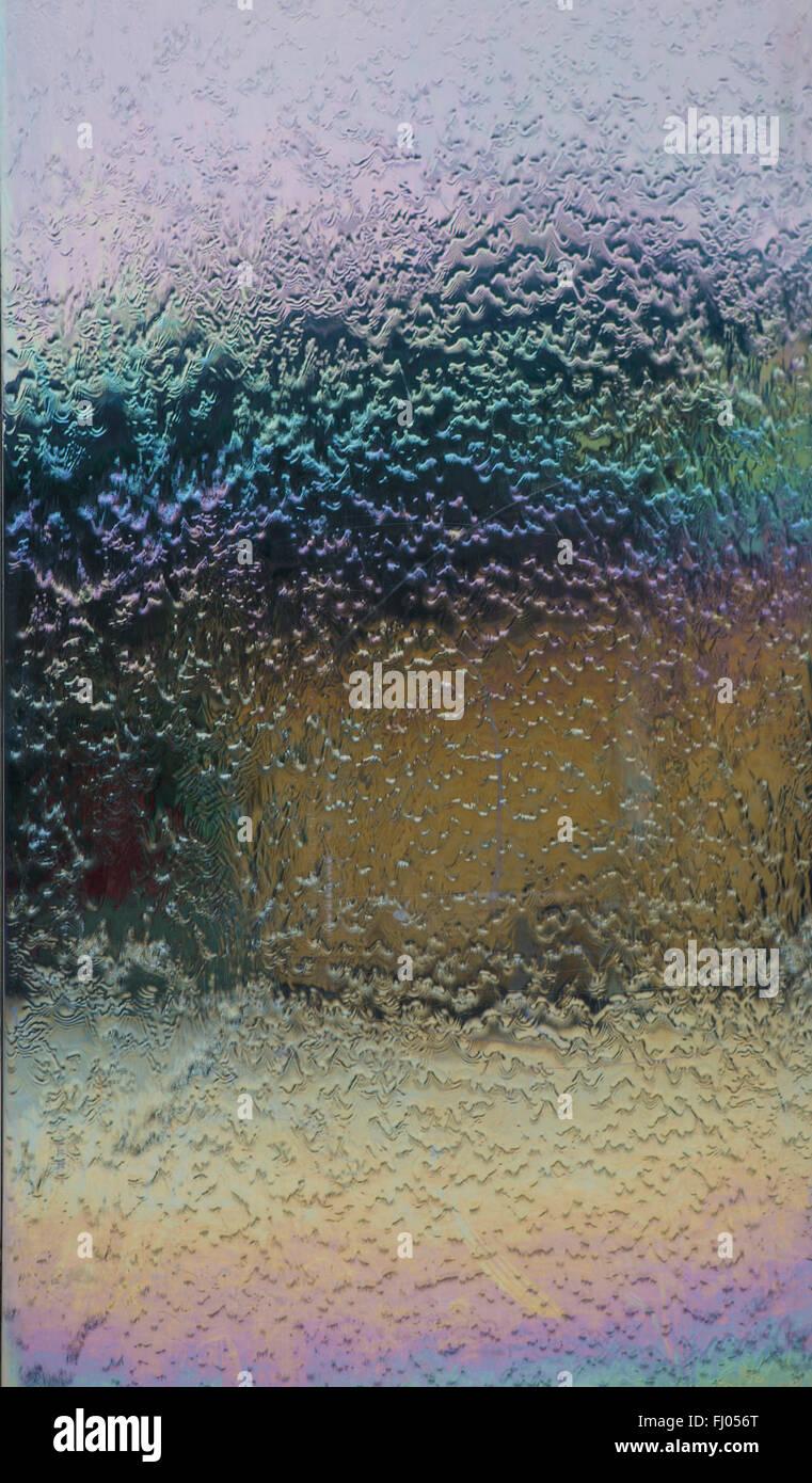 Water Running Down Stainless Steel Sheet - Stock Image