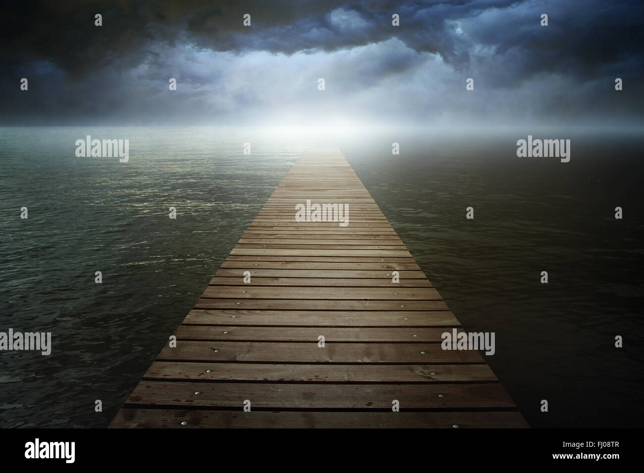 Dark cloudscape over surreal lake . Fantasy landscape - Stock Image