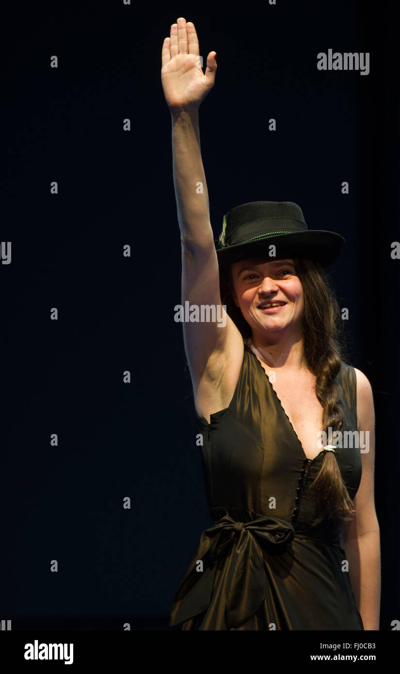 Tina Keserovic as Beate Zschaepe performs the Nazi salute, also known as Hitler salute, on stage during the photo Stock Photo