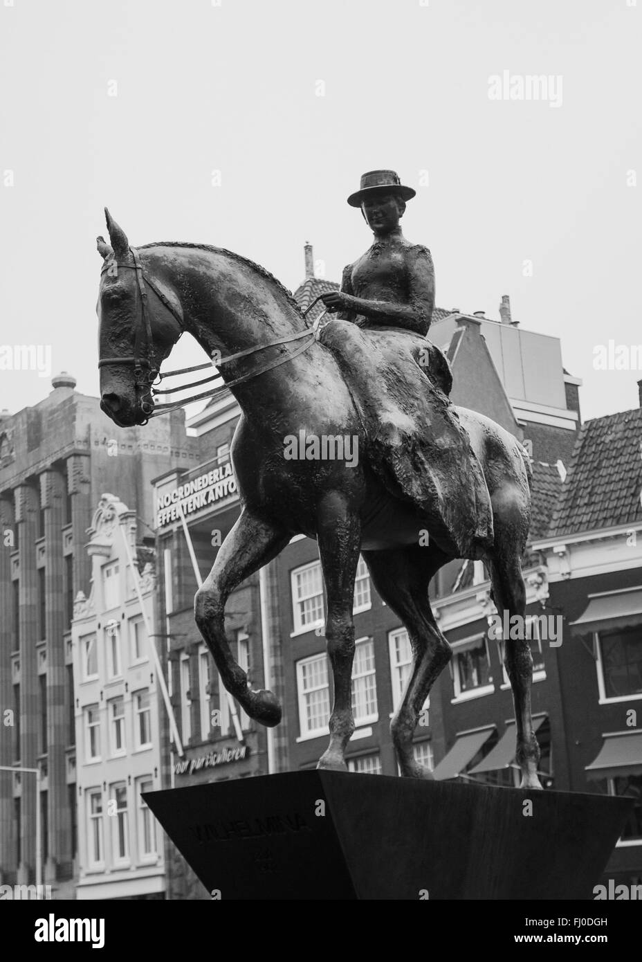 The equestrian statue on Queen Wilhelmina on Rokin in central Amsterdam Stock Photo