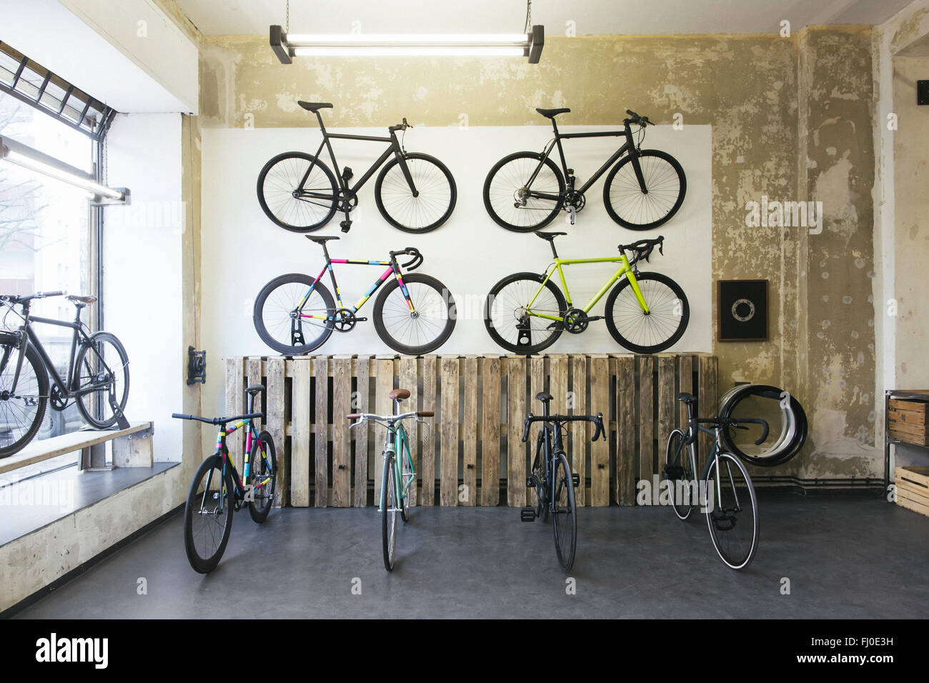 Assortment of racing cycles in a custom-made bicycle store - Stock Image