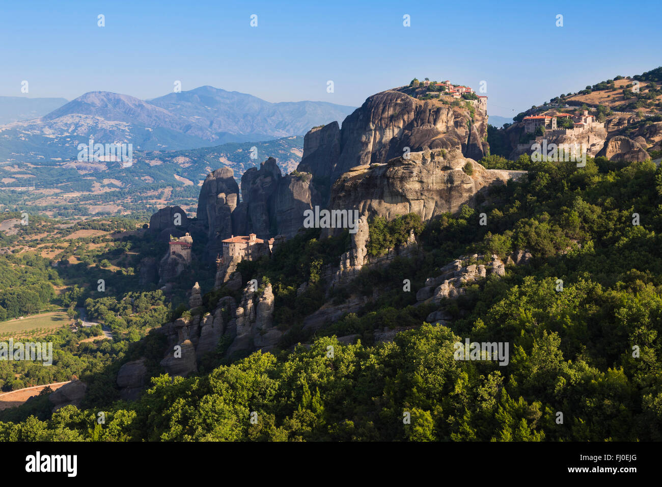 Meteora, Thessaly, Greece.  Panorama showing four of the six monasteries still used. - Stock Image