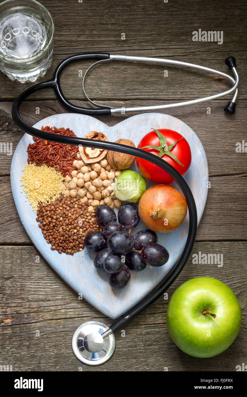 Healthy lifestyle concept with food on heart closeup - Stock Image