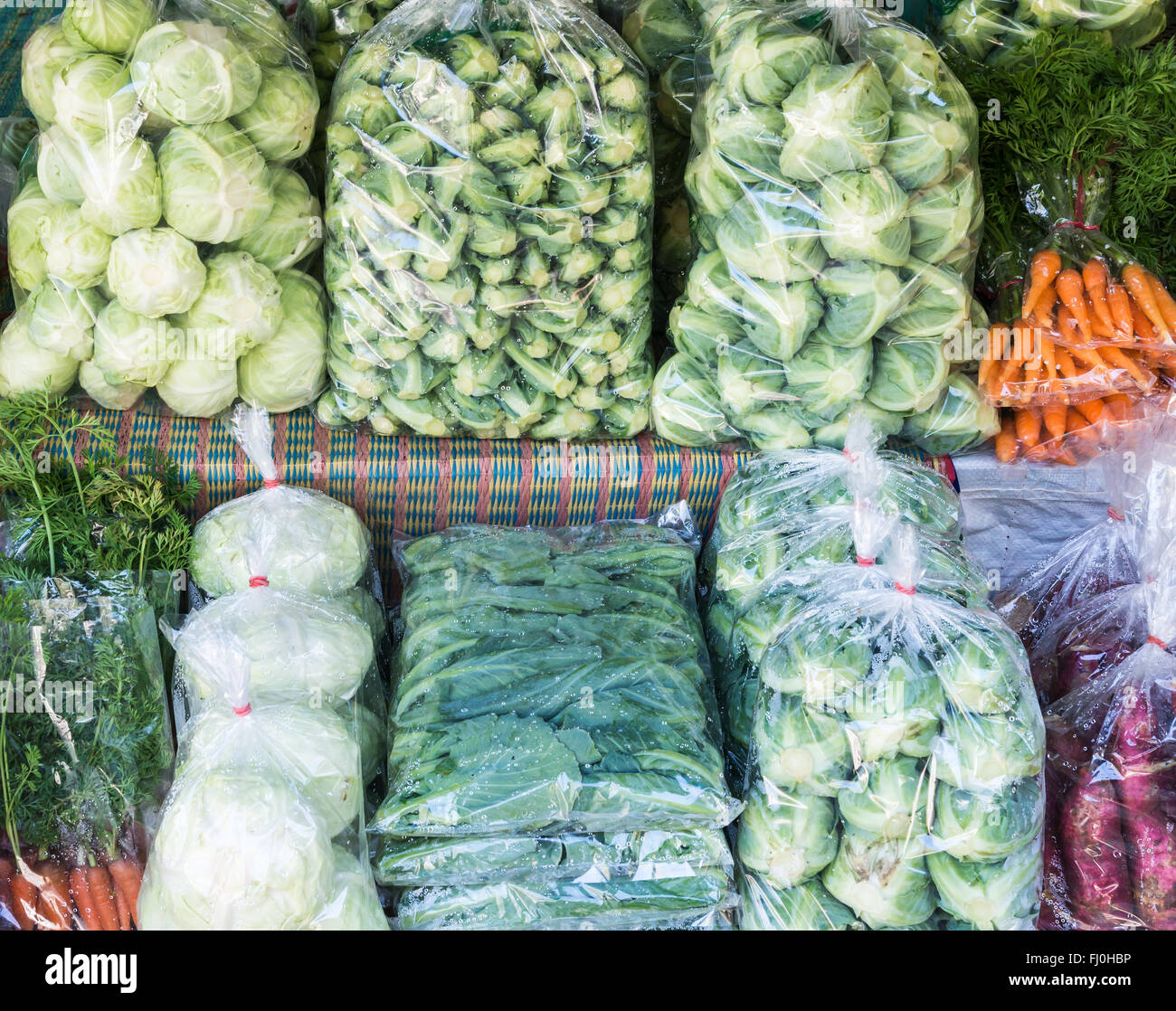fresh vegetables pack in the plastic bag in the local market.Thailand. - Stock Image