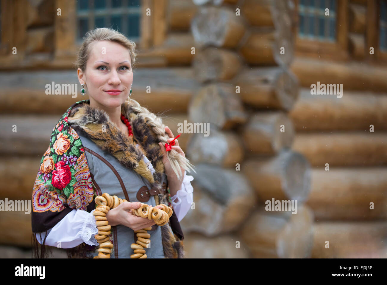 Young Russian woman in a traditional Russian headscarf, Moscow,Russia - Stock Image