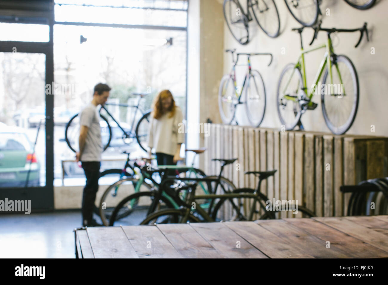 Salesman and client in a custom-made bicycle store - Stock Image