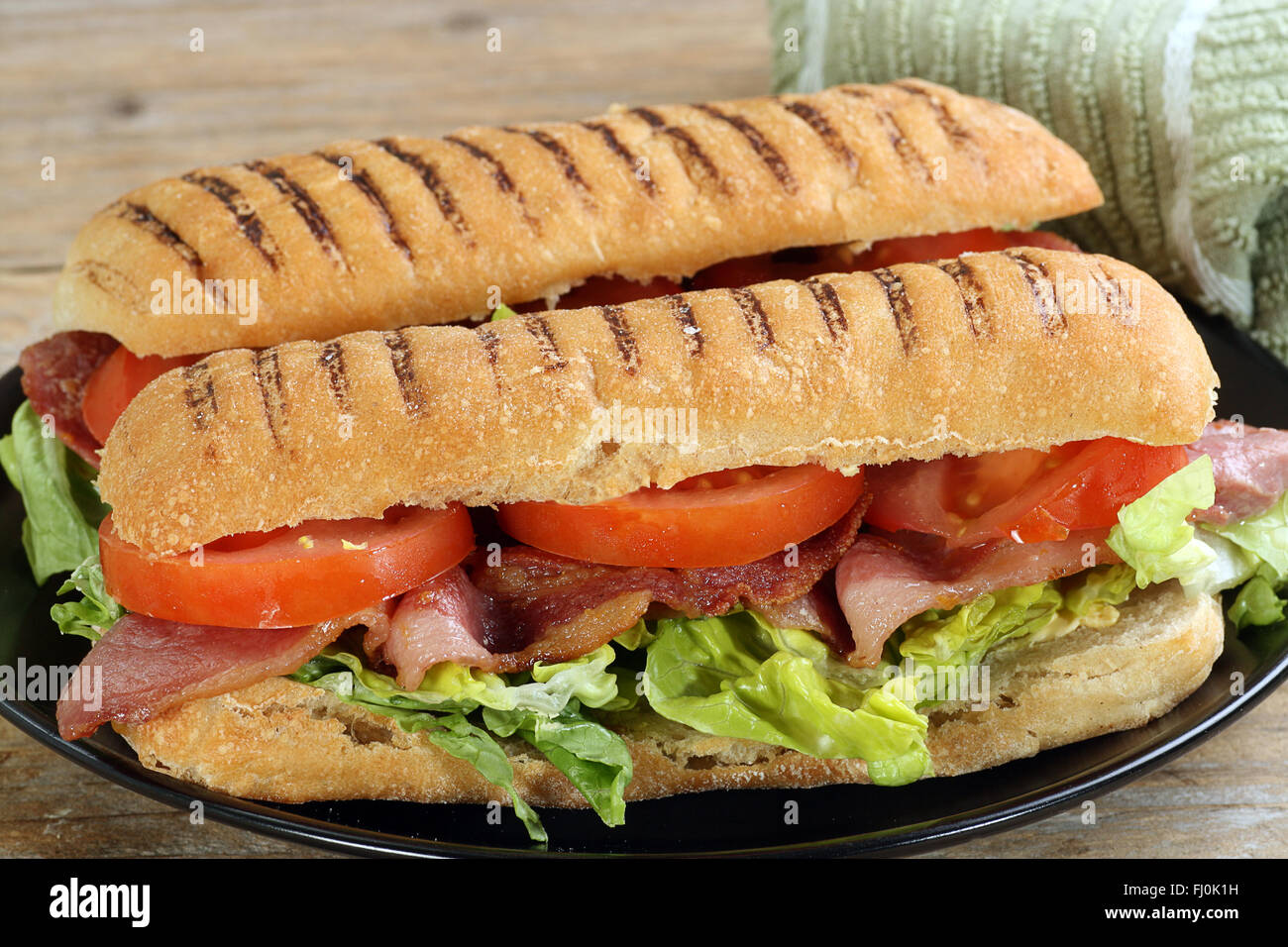 fresh panini filled with crispy bacon lettuce and tomato - Stock Image