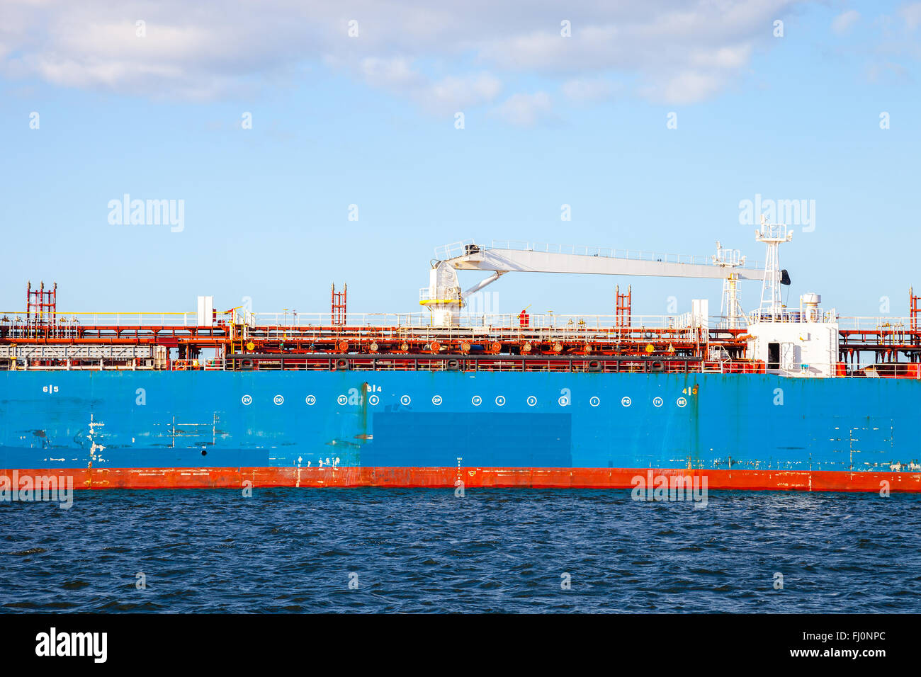 Description manifold on the deck of chemical tanker ship. Stock Photo